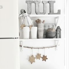 God jul! Like the idea of putting a branch between the shelf supports to hang decs on!