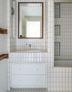 two-by-four white tiles: Earthenware Elements Field Tile in Winter Chill from Ann Sacks with off-white grout.