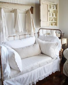 always thought of doing this with our antique iron baby bed...held our kiddos at one time