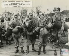 Four nurses in standard issue Army uniform carry all their gear during disembarkation onto Cape Gloucester, New Britain in August 1944 | The Digital Collections of the National WWII Museum : Oral Histories
