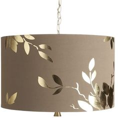 Perhaps stencil gold paint on a taupe lamp shade? Or use a Cricut and gold adhesive paper?