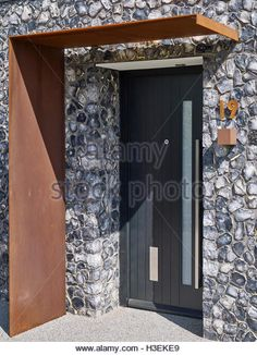 Corten Steel And Home Stock Photos & Corten Steel And Home Stock . cortenstahl Corten Steel And Home Stock Photos & Corten Steel And Home Stock Images Modern Entrance Door, Entrance Gates, House Entrance, Facade Design, Door Design, Exterior Design, House Design, Front Door Canopy, Concrete Porch