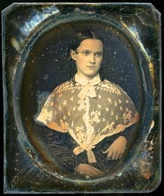 ☆ 1850s...A pretty young lady in a pereline, with a single little curl at her temple. (This daguerreotype is suffering from tarnish, discoloration, pits in the protective gass, and a badly used wooden case. The following ☆ed dag shows it restored by a PROFESSIONAL. I rather think the exposure was enhanced on this picture before it was posted.