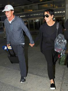 Bruce and Kris Jenner, both in their usual sunnies, walked hand-in-hand out of LAX! Perhaps their separation is over?!