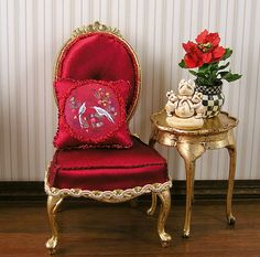 Gold-leafed chair finished in deep red silk and Christmas pillow with love birds by Maritza Moran. Miniature Furniture, Dollhouse Furniture, Miniature Rooms, Barbie, Miniature Christmas, Christmas Minis, Wicker Table, Victorian Dolls, White Wicker