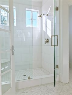 Beautiful light, airy white shower with white 12 x 24 Akdo Thassos tiles and white and light gray basketweave floor tiles, glass is coated with Diamond Fusion to help protect it from water stains. Master Bathroom Shower, Bathroom Renos, Bathroom Renovations, Bathroom Interior, Master Bath Tile, Small Master Bath, White Master Bathroom, Bathroom Showers, Bathroom Cabinets
