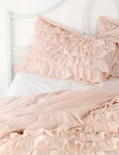 pastel pink ruffles - makes me think of a princess bedroom! Definitely want this or Delaney's next bedding set!