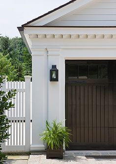great garage doors and distinct architectural details  ~ nice coach light too   ❀ ~  ◊  photo via 'anne decker architects' website