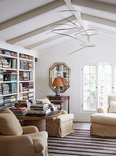 The built-ins of the library in Kendall Conrad's beautiful Santa Barbara home hold many of the things that inspire Kendall and her designs.