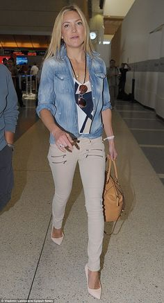 She's a fly girl! Kate Hudson displayed her sleek tresses while cutting a chic figure in skinny-leg zip-pock trousers, a white tank shirt and denim top and wedge heels on Friday ahead of catching a flight at LAX