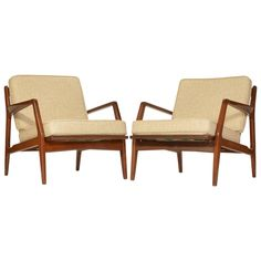 Pair of Danish Lounge Chairs by Ib Kofod-Larsen for Selig, Restored    From a unique collection of antique and modern lounge chairs at https://www.1stdibs.com/furniture/seating/lounge-chairs/