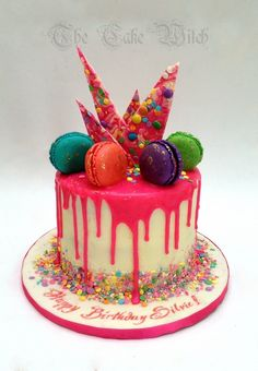 Colourful Chocolate Candy Bark Cake, white chocolate ganache with coloured ganache dripping and Macarons