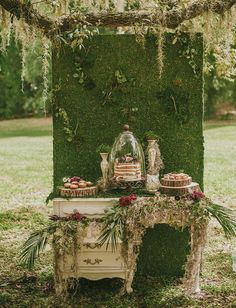 Vintage woodland cake table and dessert bar / http://www.deerpearlflowers.com/moss-decor-ideas-for-a-nature-wedding/3/