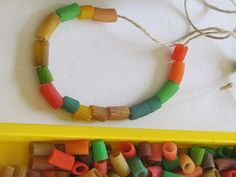 Pasta necklaces from Teach Preschool. Fun activity for the kids.