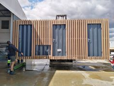 Constructed from two conjoined B-grade shipping containers, this spacious maintenance office doubles as a storage room and includes an ablution facility with a toilet and sink. Beautified with external Balau cladding, this converted shipping container office also features a fold up roof and porch, sliding windows and steel swing doors. Shipping Container Conversions, Converted Shipping Containers, Shipping Container Office, Mobile Office, Sliding Windows, Container Homes, Storage Room, Storage Containers, Cladding
