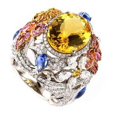 Garrard Multi Tone Gold Yellow Citrine and Sapphire Flower Ring | From a unique collection of vintage more rings at https://www.1stdibs.com/jewelry/rings/more-rings/