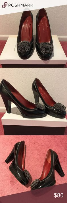 Marc by Marc jacobs black pumps Marc by Marc jacobs black patent leather heels  Zipper detailing  Zipper rose  Red insole Made in Italy  Worn but minimal flaws  Size 37 would fit size 8 women's   #marcjacobs #marcbymarcjacobs #heels #zipper #madeinitaly Marc by Marc Jacobs Shoes Heels
