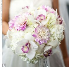 The florist combined soft white hydrangeas with more structured dahlias and orchids for a romantic look.
