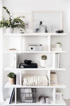 pretty open shelving! | neutral color palette, contemporary, interior design inspiration, modern living, simple, simplistic, greys, grays, inviting, diy, casual style, home, house, room, classy, chic, inviting, white, clean aesthetic, girly, fresh, plants, green living, white on white, all white everything, white shelf, shelf decor, blanket, succulent, books, bookshelf, shelving, poster