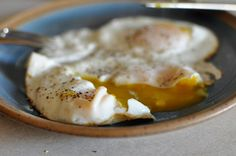 You might think I have an obsession with eggs after this post, this post,  and this post. Can you really blame me? It is the simplest and most  versatile thing in the kitchen! This may be old news to you, but you can  actually make perfectly basted eggs at home...not fried...but gorgeously  basted over-easy, over-medium, or sunny side up. Without frying. That's  just too good not to share.  Perfectly Basted Egg  Step 1: Start with fresh eggs. Make one or two at a time.  Step 2: Spray non-...