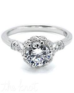 Platinum and diamond Solitaire Engagement Ring, pictured with a round brilliant-cut center stone, accented with round pave-set diamond details.