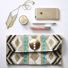 See how easy it is to create your own stamped clutch!