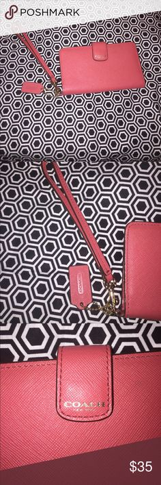 Coral pinky COACH phone/wallet wristlet 🌸Coach🌸 Wristlet to hold phone and wallet. BEAUTIFUL CORAL color and has gold hardware that is detachable. Coach Bags Clutches & Wristlets
