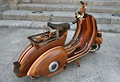 wooden vespa... as soon as I don't need to take Molly to school anymore I am rockin' a vespa as much as humanly possible, hopefully in pistachio color though...