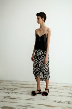 Sharon Wauchob Resort 2015 Black camisole and flowing printed sarong or skirt.