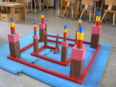 Montessori sensorial materials being used together by a child