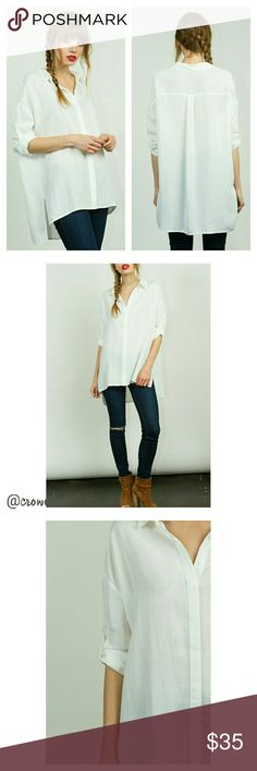 """HPOversized White Button Down Oxford Great oversized white button down top, hi-low style hem, collar, long sleeve with 3/4 button tab, lightweight and comfortable!   100% lightweight Polyester  SMALL Bust 48"""" Waist 48"""" Length 26"""" MEDIUM Bust 50"""" Waist 50"""" Length 26.5"""" LARGE Bust 52"""" Waist 52"""" Length 27""""  All measurements are flat lay.  No stretch. Boutique  Tops Button Down Shirts"""