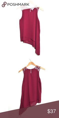 🎁SALE🎁 Burgundy Asymmetrical Top Ohh la la 😍 This top is definitely a head turner! Has a lining underneath. No trades. No low ball offers. Tops