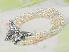 Lacewing Bracelet, 1920's, from artbeads.com board.  Look at the detail on the butterfly.