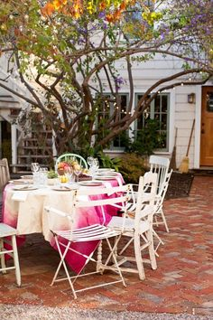 The linked article is actually How To Dip Dye a Tablecloth — Projects from The Kitchn, but nice backyard porch inspiration.
