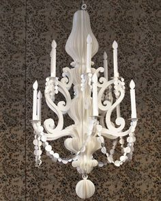 This chandelier is made out of paper, and is perfect to hang in trees for an outdoor wedding. Super unique.