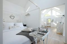 Recently completely and beautifully renovated using traditional materials, the single-storey building has an urban coastal style and is decorated throughout in cool white and shades and patterns of grey, creating a wonderful light and airy ambience. Interior Color Schemes, Colorful Interiors, White Interiors, Coastal Style, Cottage, Traditional, Living Room, Cool Stuff, Bedroom