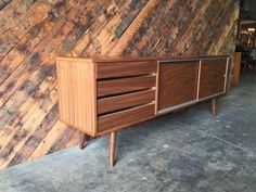 Mid Century Style Custom Credenza features sliding doors, plenty of storage and metal trim finishes L:71.95 W:15.75 H:29.5