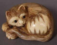 30: Carved Ivory Netsuke of a Cat, Japanese, 20th C.