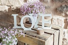 The talented creations by https://www.etsy.com/uk/shop/WeddingCreationsUK , photographed in the summer house at Lyde Arundel by http://www.theresafurey.com Love sign on Etsy, £10.00