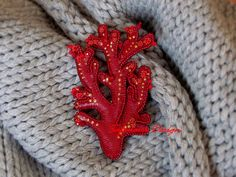 Coral leather brooch.