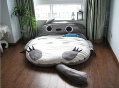 There is a Totoro Design bed! one or Double Totoro bed.Your children would love it. Cute Giant Totoro cushion bed very cute. Its fulfilled with high quality 100% PP cotton and its 100% green product. Giant sleeping bag, dream in Totoro A surprise for your beloved/kids Half stand and act as a ...