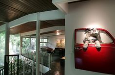 Whimsical art resembling their former dog greets visitors to Joy and Randy Miltenberger's 1957 Mid-Century Modern home. Robert Cohen, rcohen@post-dispatch.com