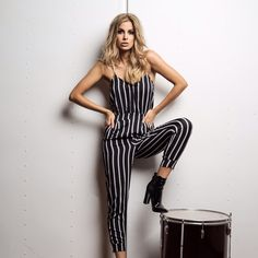 PINSTRIPE PANT JUMPSUIT Black & white pinstripes have made their way into our collection in romper form. Perfect for a casual day in the city or night out with the girls. Pair it with black heels or sandals depending on the occasions. Comfortable and oh so stylish. No doubt, this will become your go-to timeless piece. Belt is not included.   Black and White Jumpsuit Pinstripes Spaghetti straps Skinny leg 100% Polyester Style Link Miami Pants Jumpsuits & Rompers