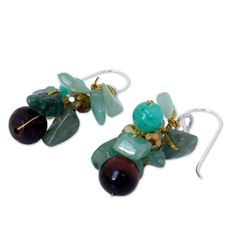Thailand's Nareerat orchestrates a colorful harmony with the design of these earrings. Crafted by hand, dyed quartz, glass and red tiger's eye hang from sterling silver earrings.