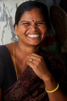 Shanti, her husband, and three children, counted among India's 60 million landless, poor families until 2006 when she was able to purchase one acre through a government-subsidized land purchase programme. Now, she and her family can grow much of the food they need and sell the excess. That extra income allowed Shanti and her husband to invest more in their children's education and make improvements to their home.   PHOTO: Andhra Pradesh/UNDP Picture This Photo Contest