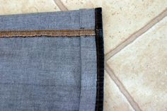 A SUPER easy way to hem jeans while maintaining the original cuff.  A must have trick for all shorties.