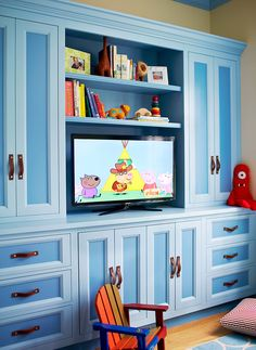 blue playroom built-in with leather pulls // Andrew Howard