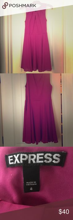 Beautiful pink/purple colored dress Great dress for going out, work or casual. Well made. Modest slit in front. Zipper on the side Express Dresses Midi