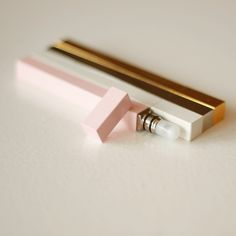 minimalist japanese perfume sticks — cute, unique design. Love the feminine colours