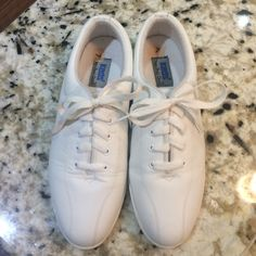 """1970's Vintage white leather Keds NWOT Casual style Keds from the 1970's. A pair of shoes by Keds that is not their traditional """"Champion style."""" Completely unused, new without tags. keds Shoes Sneakers"""